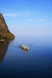 Boat in the Small Sea Strait of Lake Baikal Stock Image