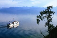 Boat in the Small Sea Strait of Lake Baikal, Russia Stock Photos