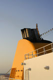 Boat Smokestack. Yellow boat turret with a series of smoke stacks on top.  Orange and blue are dominant colors Royalty Free Stock Photography