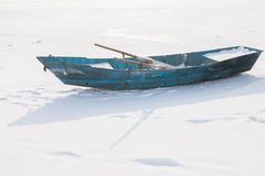 Boat in  snow Stock Photo
