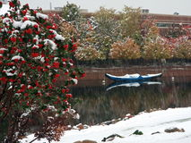 Boat and snow falling in Minnesota Royalty Free Stock Photos