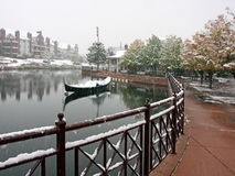 Boat and snow falling into the water Royalty Free Stock Photo