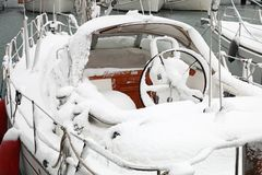 Boat with snow in harbor Royalty Free Stock Photography