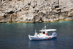 Boat in Sostis Bay. Cretan beach. Mediterranean sea. Greece Stock Image