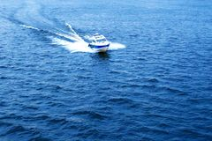 Boat speed rushes through the water.  Stock Photos