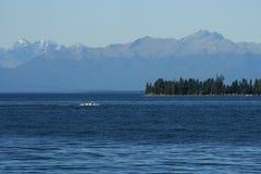 Boat speeding across lake Te Anau Royalty Free Stock Images