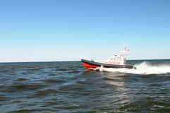Boat speeding across water Stock Image