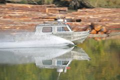 Boat Speeding Across Water Stock Photos