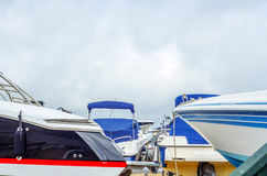 Boat on stand on the shore, close up on the part of the yacht, l. Uxury ship, maintenance and parking place boat, marine industrial Stock Images