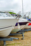 Boat on stand on the shore, close up on the part of the yacht, l. Uxury ship, maintenance and parking place boat, marine industrial Royalty Free Stock Photo
