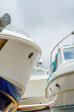 Boat on stand on the shore, close up on the part of the yacht, l. Uxury ship, maintenance and parking place boat, marine industrial Stock Photography