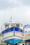 Boat on stand on the shore, close up on the part of the yacht, l. Uxury ship, maintenance and parking place boat, marine industrial Stock Photo