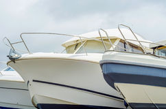 Boat on stand on the shore, close up on the part of the yacht, l. Uxury ship, maintenance and parking place boat, marine industrial Stock Image