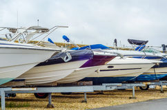 Boat on stand on the shore, close up on the part of the yacht, l. Uxury ship, maintenance and parking place boat, marine industrial Royalty Free Stock Images