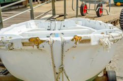 Boat on stand on the shore, close up on the part of the yacht, l. Uxury ship, maintenance and parking place boat, marine industrial Stock Photos