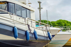 Boat on stand on the shore, close up on the part of the yacht, l. Uxury ship, maintenance and parking place boat, marine industrial Royalty Free Stock Image