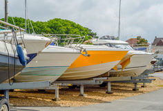 Boat on stand on the shore, close up on the part of the yacht, l. Uxury ship, maintenance and parking place boat, marine industrial Royalty Free Stock Photography