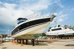 Boat on stands. In dry dock for repair Royalty Free Stock Images