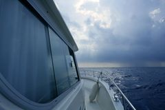 Boat starboard side on a cloudy storm Royalty Free Stock Images