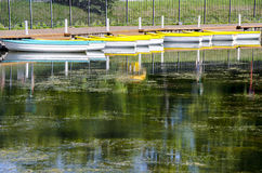 Boat station. Boats on the lake in the Park Royalty Free Stock Image