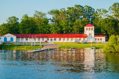 Boat station building and boats near the bank of the Volkhov river in Veliky Novgorod, Russia Stock Photography