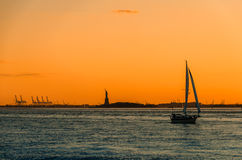 Sunset sailing towards the Statue of Liberty Royalty Free Stock Photo