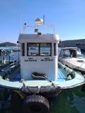 Boat staying at Burgazada Istanbul island at Marmara sea port at sunny day stock photos