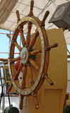 Boat Steering. A large wooden steering wheel on a sailboat Royalty Free Stock Image