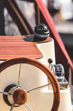 Boat steering wheel with compass Stock Photo