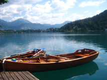 Boat on a still lake Stock Image