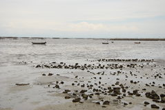 Boat and stone in the sea. There are boat and stone in the sea.this place is in east of thaiand Royalty Free Stock Images