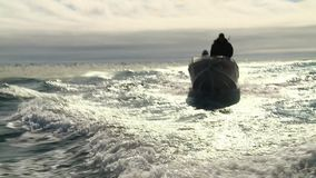 The boat and the storm. Boat with hunters in the storm stock footage