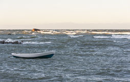 Boat in stormy sea Stock Photo