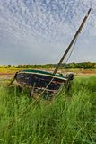 Boat stranded in the grass royalty free stock photos