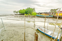 Boat stranded on major routes at low tide Stock Image