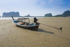 Boat Stuck on the Sand Beach Stock Photo
