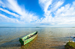 Boat on summer lake bank. Old wooden fishing boat on summer lake bank (Svityaz, Ukraine Stock Images
