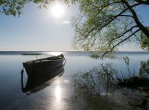 Boat sun lake summer green wood tourism stock photography