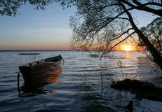 Boat sun lake summer sunset holiday wide royalty free stock photography