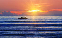 Boat at the sunrise Royalty Free Stock Image