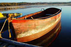 Boat at sunrise. Ferreous  boat in the lake in the early morning at sunrise Royalty Free Stock Photography