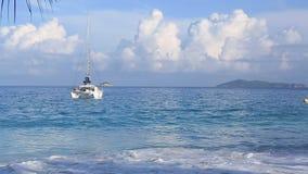 Boat at sunrise on the beach Anse Lazio stock video