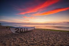 Boat 2019 on the beach and sea sunrise, new year morning stock photography