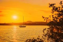 Boat at Sunrise at Porto Rotondo. At Costa Smeralda in Mediterranean sea, Sardinia, in Italy stock photography