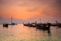 Boat in sunrise sea Stock Images