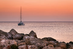 Boat at sunrise on the shore of the island of Rhodes. Greece Stock Images