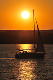 Boat at sunset. Sailing boat silhouette at sunset from lake Balaton (Hungary stock photos