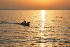 Boat at sunset. Boat with fishermen on sea with sunset Stock Image