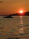 Boat in sunset. On Adriatic sea Stock Image