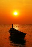 Boat in sunset. One boat in sunset Silhouettes Stock Photo